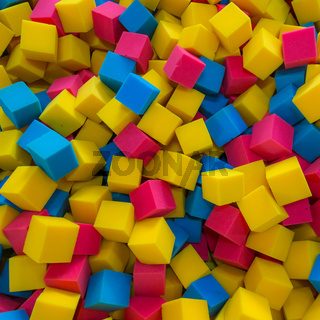 Colored foam rubber cubes background
