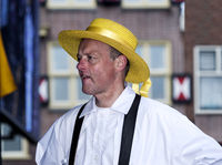 member of the cheese carriers guilde wearing a yellow hat, Cheese market, Alkmaar, Netherlands