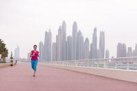 woman running on the promenade