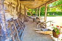 Traditional wooden cottage and agricultural tools in rural region of Croatia