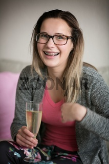 Girl in glasses and with brackets on teeth