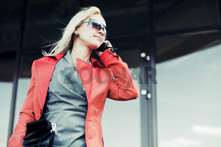 Young fashion woman calling on the cell phone