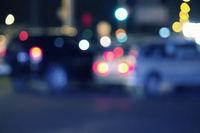 Blurred urban night scene defocused cars in the street.