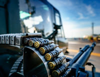 Bullets on Ammunition Belt Attached to Gun o Helicopter