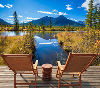 Two chairs and round table on the lake
