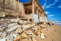 Damaged beach houses. Spain