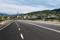 empty country road near hill in europe