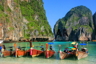 Longtail boats anchored at Maya Bay on Phi Phi Leh Island, Krabi Province, Thailand