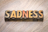 sadness word abstract in wood type