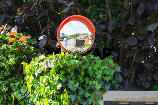 Surveillance mirrors or traffic mirror at a junction.