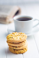Sweet pistachio cookies and coffee mug.