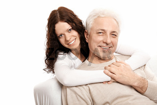 The daughter embraces the father on a white background