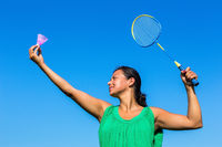 Colombian woman serve with badminton racket and shuttle