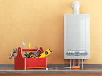 Gas boiler servicing or repearing concept. Toolbox with tools on the kitchen.
