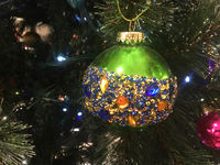 Green Christmas tree bauble embellished with amber blue and gold faceted crystals