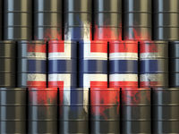 Oil fuel of Norway energy concept. Norwegian flag painted on oil barrels.