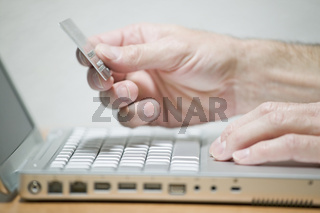 Man using credit card online