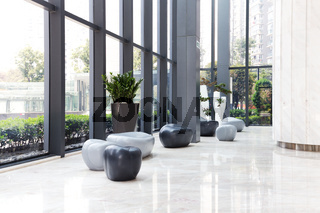 elegant stools and talbe in huge and bright hall