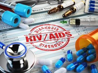 HIV AIDS diagnosis. Stamp, stethoscope, syringe, blood test and pills on the clipboard with medical report.