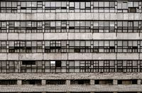 Vintage 70s housing in St Petersburg Russia grunge wall with closed windows and rusty metal grids