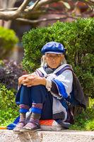 Lijiang Traditional Dressed Naxi Woman Sitting