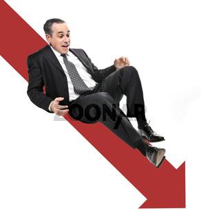 Businessman sliding down red arrow