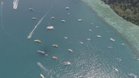 Aerial drone photo of sailing boats and yachts in the bay of iconic tropical Phi Phi island