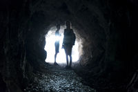 blurred people in a dark tunnel