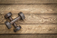 dumbbells on wood - exrecise concept