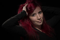 Portrait of a young woman with red hair