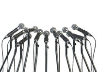 Microphones prepared for press conference or interview isolated on white