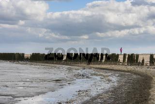 Mud-flats of Waddensea with Girl