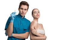 Plastic surgeon with his female patient portrait