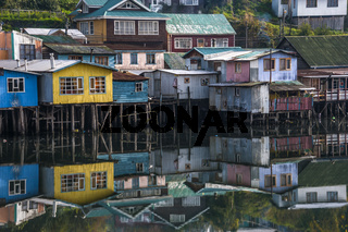 Palafito houses above the water in Castro, Chiloe, Chile