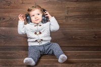 infant boy listen music with headphones