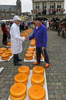 A cheese merchant, left,and a farmer,right, bargain over the price of Gouda cheese,Gouda,Netherlands