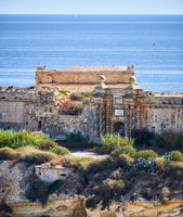 The south gate of Fort Ricasoli as seen from Kalkara over the Rinella bay, Malta.