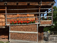 timber house; stacked firewood; wooden pile; dolomite alps; Italy; Europe;