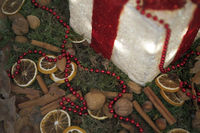 Christmas decoration with cinnamon, nuts, orange peel