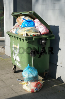 overflowing garbage container