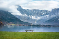 Austrian Alps and a bench on lakeside