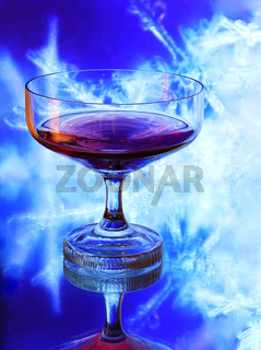 Glass of Cognac isolated on blue background