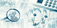 Financial market with magnifier and calculator