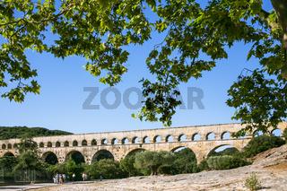 tourists go to ancient Roman aqueduct Pont du Gard