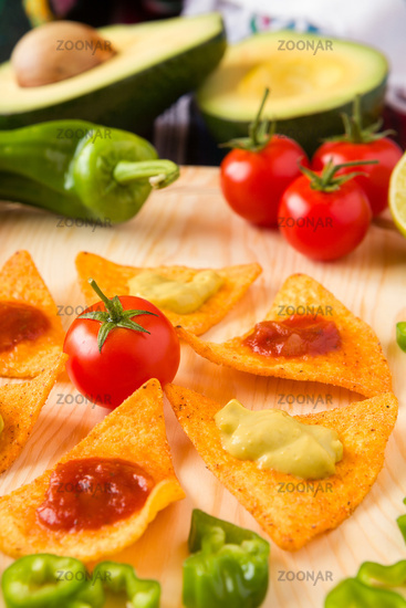 Close up of nachos chips tomato pepper and avocado