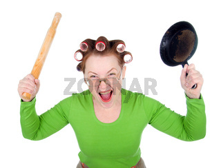 Angry housewife in hair rollers is holding