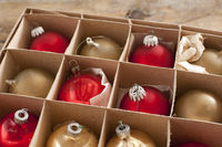 Cardboard box of colorful Christmas decorations
