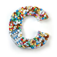 Letter C. Set of alphabet of medicine pills, capsules, tablets and blisters isolated on white.
