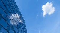 a cloud reflecting in a modern building