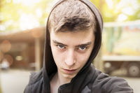 portrait of a cool looking young man with hoodie
